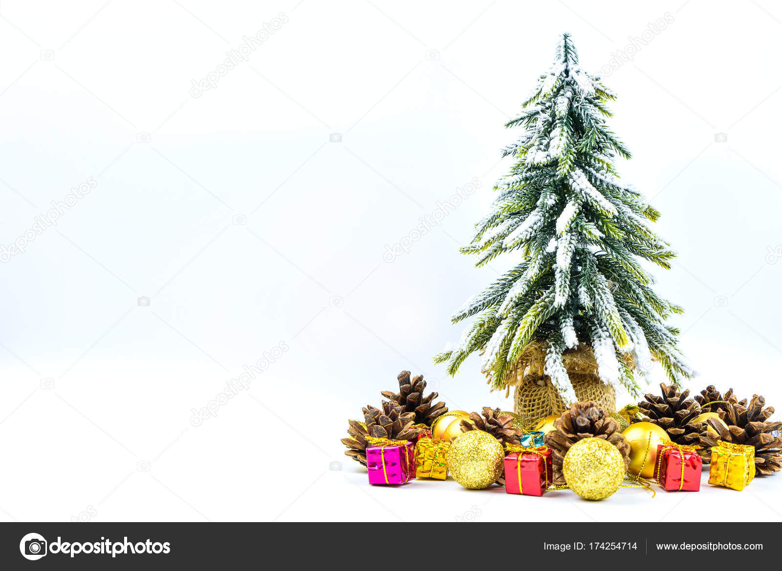christmas or new year background with pine conesgift boxgolden ball and pine tree of xmas decorations and fir branches flat lay blank space for a