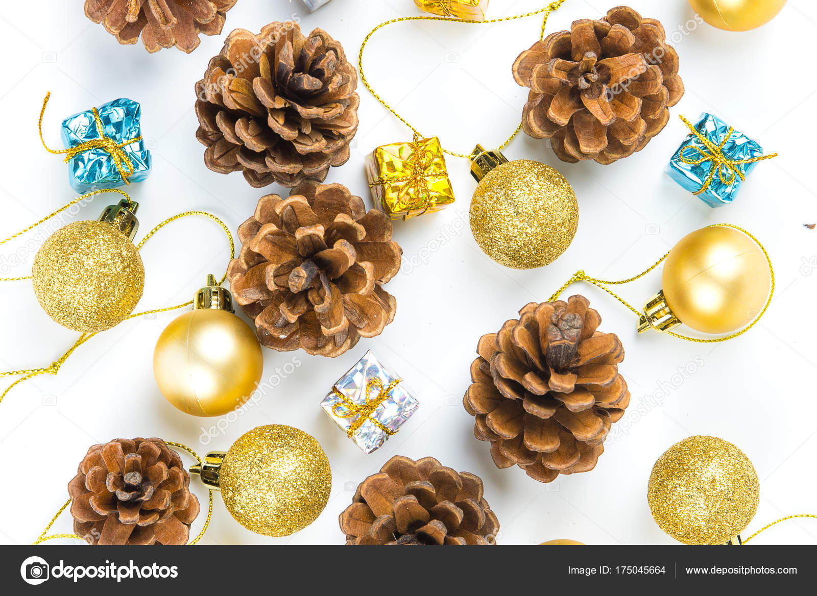 christmas or new year background with pine conesgift box on red ribbongolden ball of xmas decorations and fir branches flat lay blank space for a