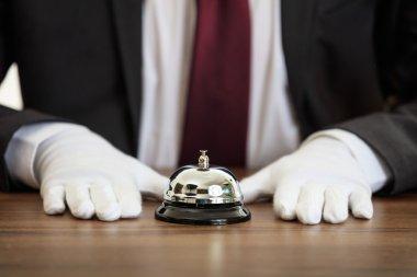 Butler service bell on a wooden desk