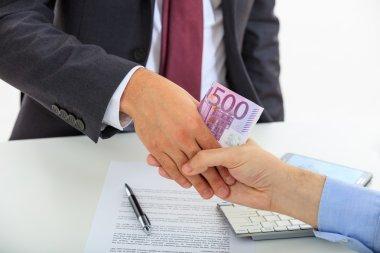 Handshake with euro money