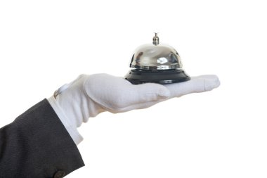Butler service bell in a gloved hand