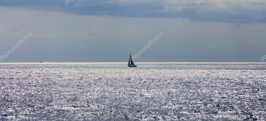 Sailing boat in blue sea