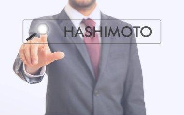 Man pointing at word Hashimoto