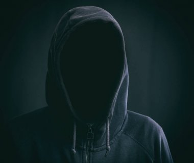 Hooded man on black background