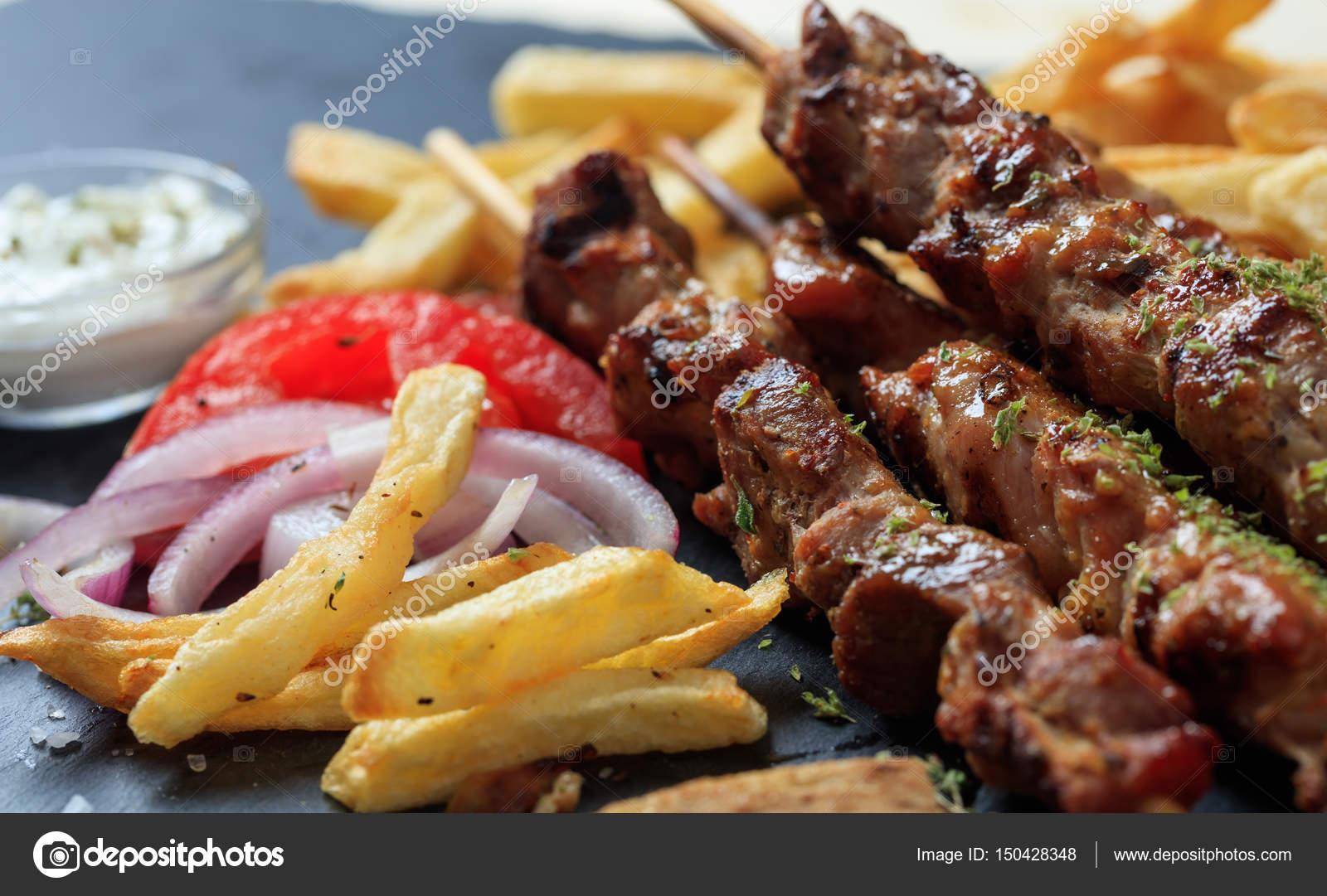 Image De Plat De Cuisine grilled meat skewers and side dish — stock photo © gioiak2