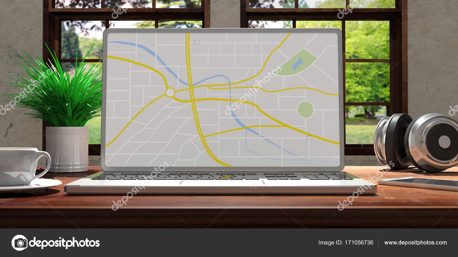Ordinateur portable avec écran de la carte sur le bureau en bois à