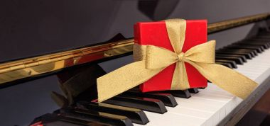 Red gift box on piano keyboard