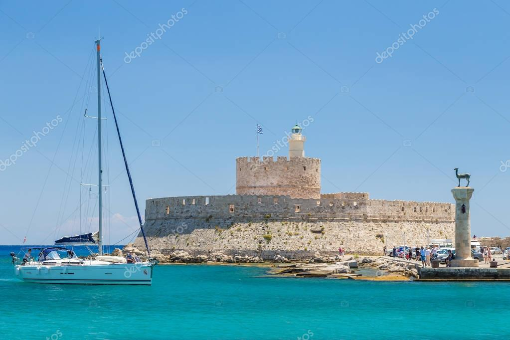 19 JUNE 2017. People in Mandraki port of Rhodes town, Greece
