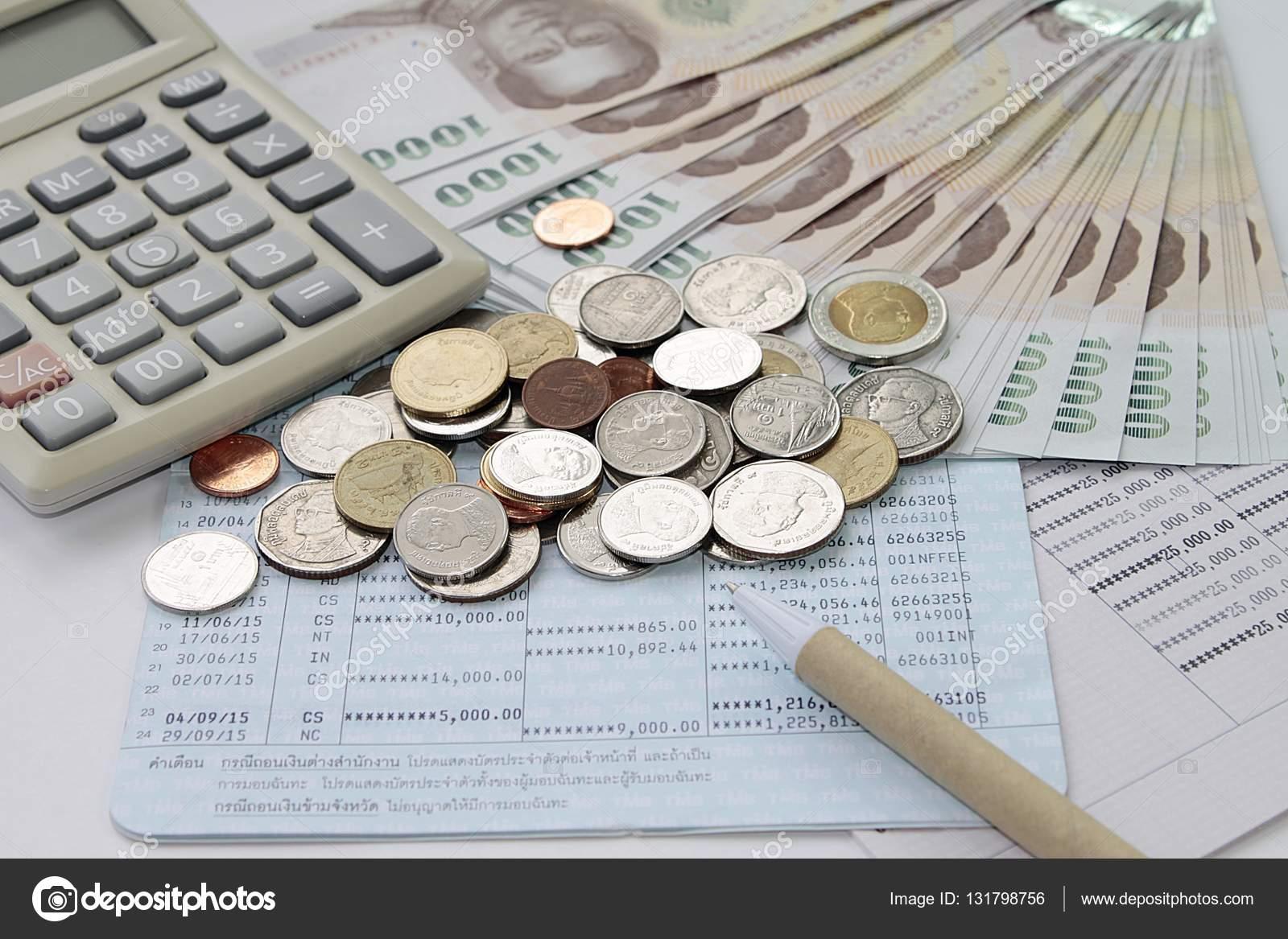 Coins, Thai Baht Money, Calculator And Pen On Savings Account Passbook U2014  Stock Photo