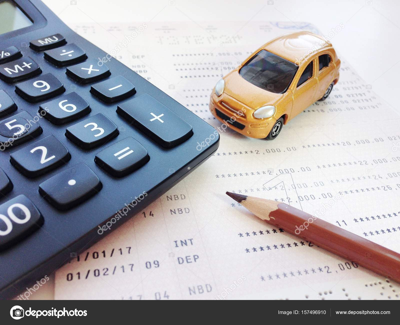 Miniature car model, pencil, calculator and savings account ...