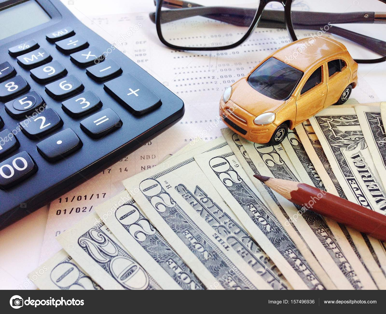 Miniature car model, pencil, money, calculator, eyeglasses and ...