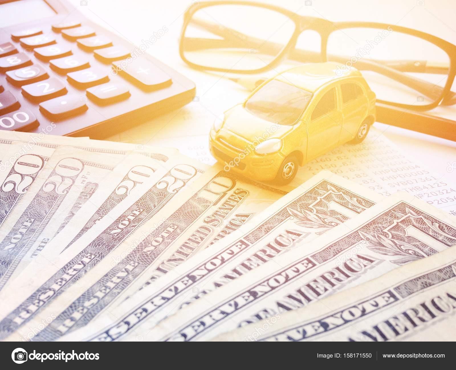 Business, Finance, Savings, Banking Or Car Loan Concept : Miniature Car  Model, Pencil, Calculator, Eyeglasses, Money And Savings Account Passbook  Or ...