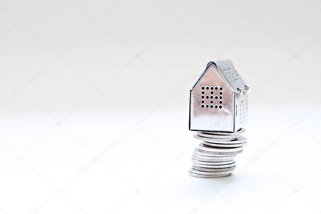 Business, finance, saving money, property ladder or mortgage loan concept : House model standing on coins stack