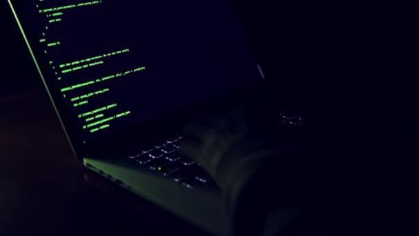 Hacker typing code.