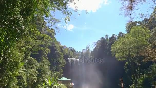 Grandiose waterfall in jungle.