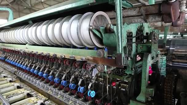 Industrial machinery for the production of silk thread.