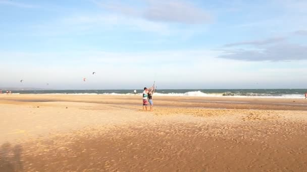 Panoramic view how instructor teaches the beginner to ride a kite surf.