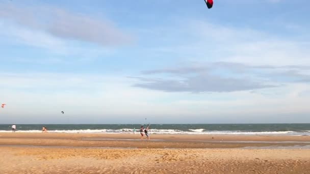 Instructor teaches the beginner to kite surfing.