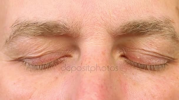 Sleeping adult man open his eyes. Extreme close-up view. Human eyes fast open up.