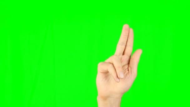 Gesta se 2 prsty přední pohled zelené pozadí. Klepněte na snímek poklepáním výpad