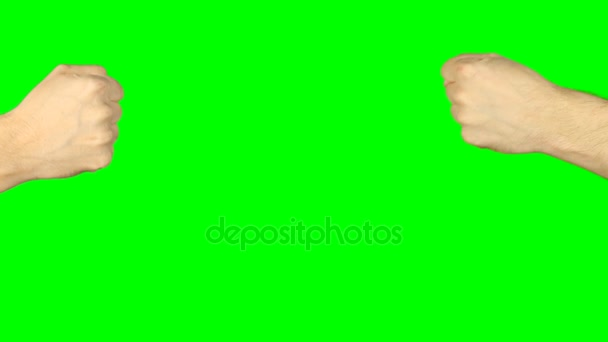 Rock paper scissors hand game. Two hands top aerial view. Green screen chroma key alpha matte.