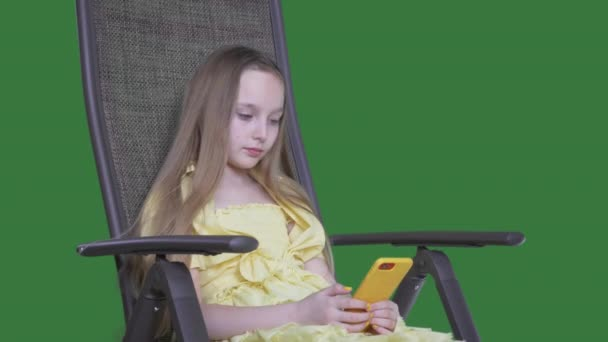 Beautiful teenage girl using smartphone