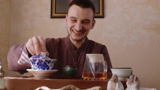 Happy tea master preparing hot tea