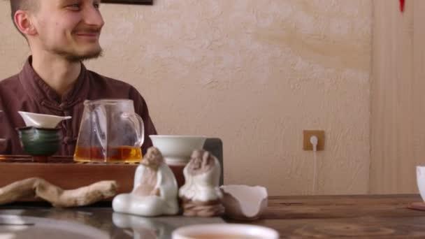 Happy tea master talking with interlocutor during tea ceremony