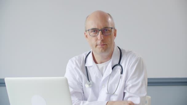 Portrait male doctor saying no while online consultation in medical office. Point of view practitioner doctor talking with patient in hospital office. Remote medical consultation.