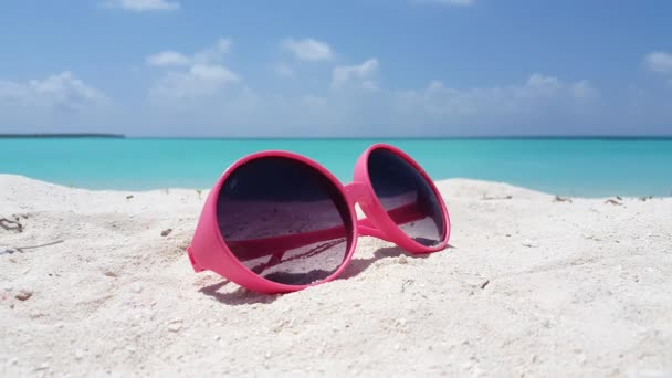 Sunglasses on the shore. Vacation season in Bali, Indonesia.