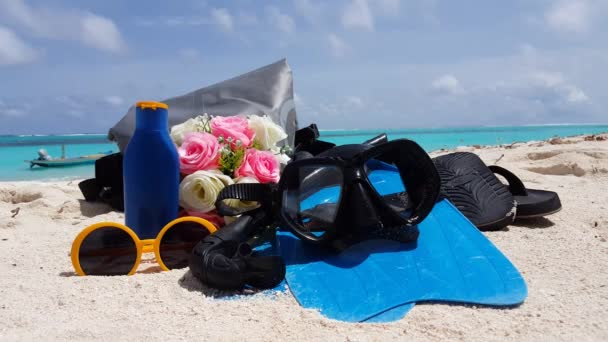 Diving set with wedding bouquet on sandy beach. Scenery of Seychelles, East Africa.