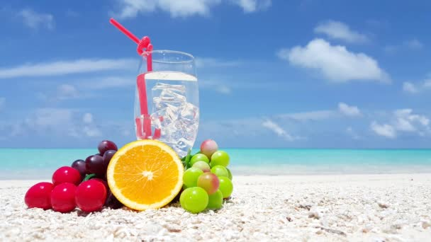 Drink with straw and fruits on the beach. Exotic nature of Dominican Republic, Caribbean.