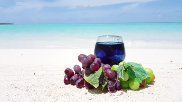 Grapes with wine on the beach. Exotic nature of Dominican Republic, Caribbean.