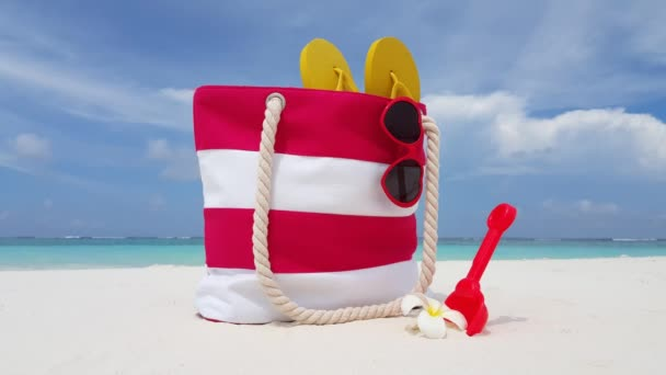 Beach bag on the beach. Tropical nature of Bali.