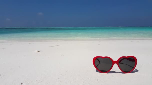 Red sunglasses on the beach. Summer mood in Bali, Indonesia.