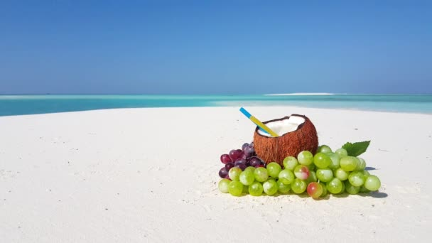 Coconut drink on the beach. Idyllic nature of Bali.