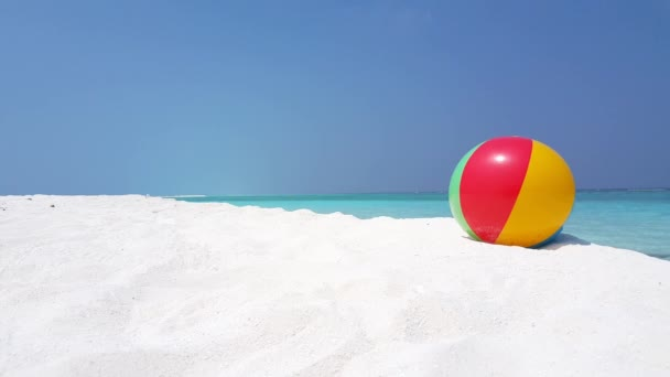 Inflatable ball toy on the beach. Scenery of Seychelles, East Africa.