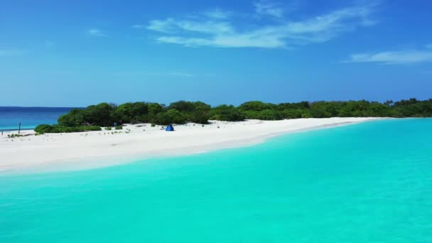 Tropical green island with white beach and turquoise water. Vacation on Antigua and Barbuda, Caribbean.