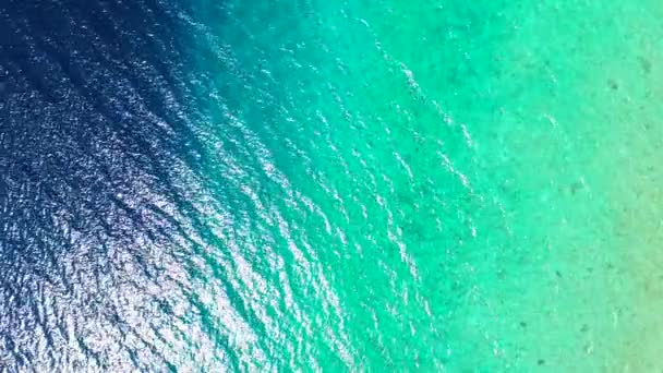 Top view of rippled turquoise water. Summer relax in Maldives, South Asia.