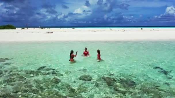 Tropical getaway retreat on exotic beach. Females friends relaxing on virgin beach in Maldives.