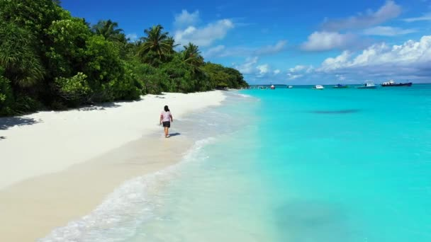 Aerial view, summer colorful seascape, amazing tropical curve beach. Beautiful woman walking on paradise sandy seaside.