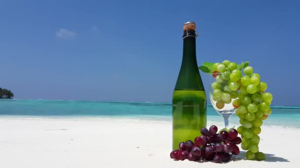 Champagne with grapes on the beach. Idyllic nature of Bali.