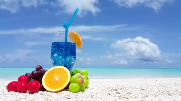 Fruits with drink on the shore. Summer tropical scene at Dominican Republic, Caribbean.