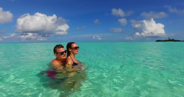 Young couple relaxing together on summer vacation in Maldives.