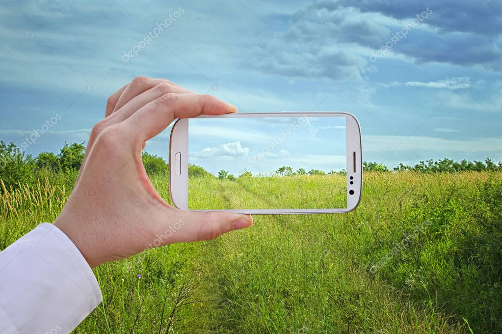 Travel concept - Taking a picture with a smart phone