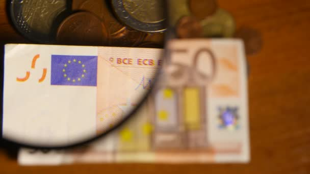 Magnifying Glass Over Euro Notes
