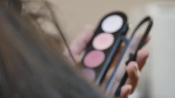 Makeup. Woman Make-up Applying closeup. Eyeliner. Cosmetic Eyeshadows. Eyeline brush for Make up. Beauty Girl with Perfect Skin. Eyelashes. Brown eyes. Makeover