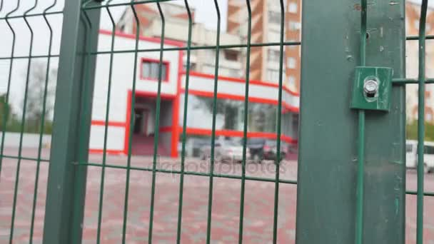 automatic green gates on a background of red buildings