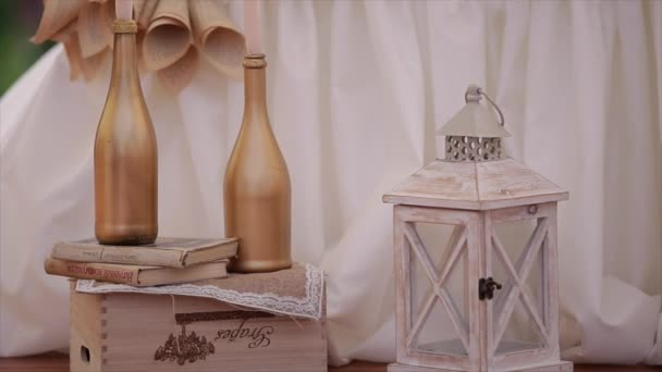 Wedding decorations with candles and bottle