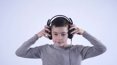 Happy teen boy with headphones, isolated on white background
